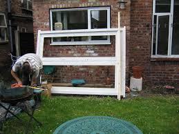 Pose d'une porte fenêtre en rénovation